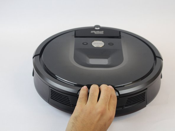 Remove the dust bin by pressing down on the rear button on the device.