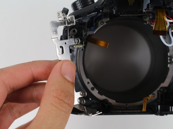 Pull out the metal plate inside the camera near the audio jack.