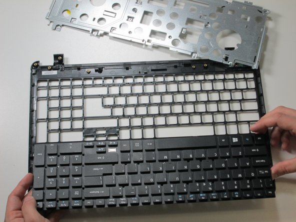 Flip panel towards you to take out keyboard.