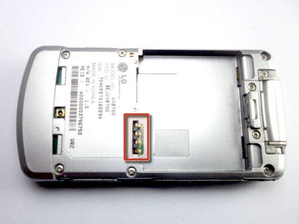 When installing the battery, make sure to align the metal pins with those of the phone.
