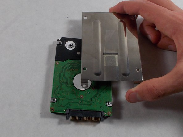Lift the casing off the hard drive.