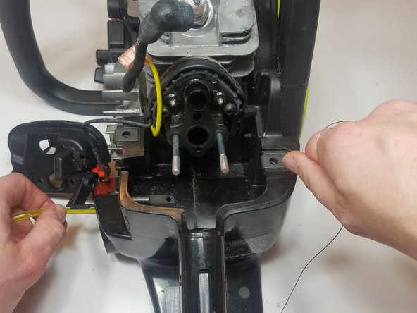 Feed the fuel line through the gas tank while pulling the wire.