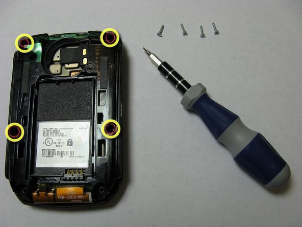 Image 1/1: Remove the four screws from the back of the phone with the T6 Torx Screwdriver.