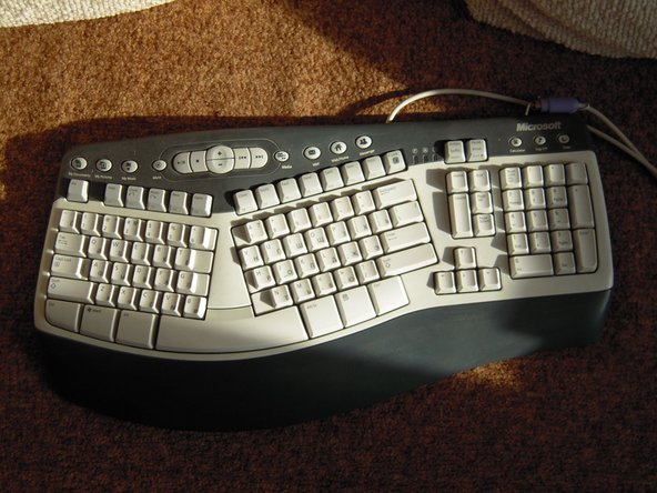 A guide showing how to disassemble and clean a Microsoft Natural Multimedia Keyboard.