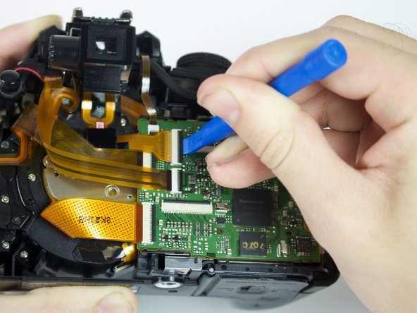 Image 1/2: Once the connector has been opened, gently pull the cable from its slot.