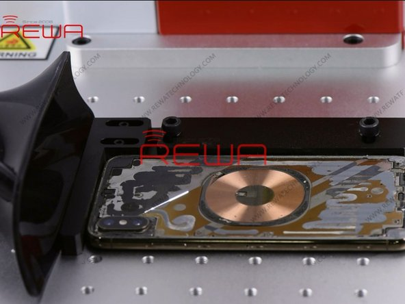 Once the back glass has been separated completely, scan with the laser light to remove residual glue on the mid-frame.