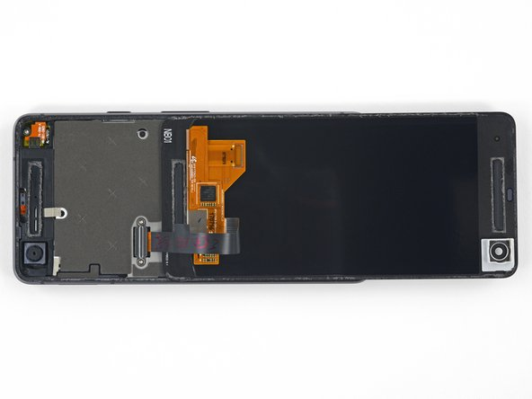 Carefully lay the display down on top of the rear case as shown, making sure not to crease or tear the display ribbon cable.