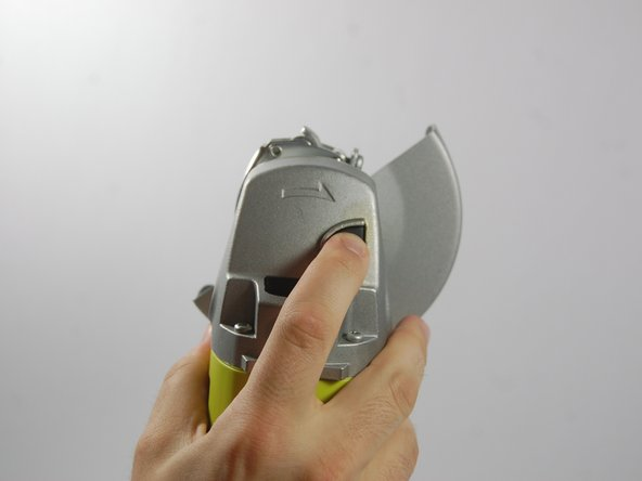 Image 2/3: With the spindle lock button held down, use the wrench provided to loosen the clamp nut. Once loose, you can use your fingers to unscrew the nut completely