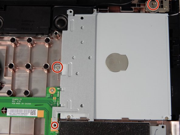 Using the the Phillips head #00 screwdriver remove the two screws around the disc drive.  Two screws securing the disk drive (5cm)