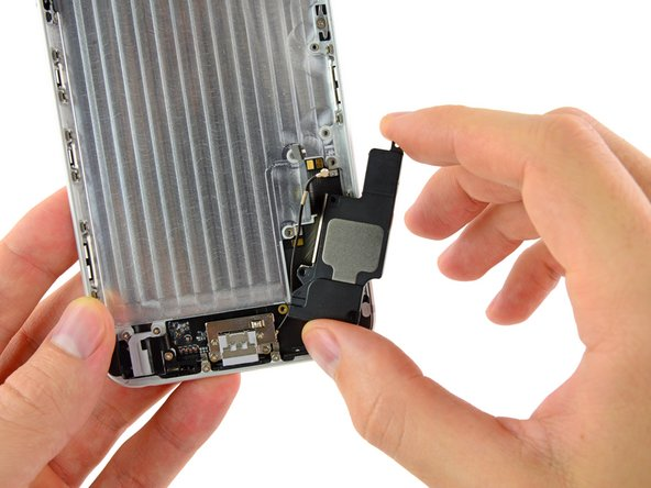 Lift and remove the speaker out of the iPhone.
