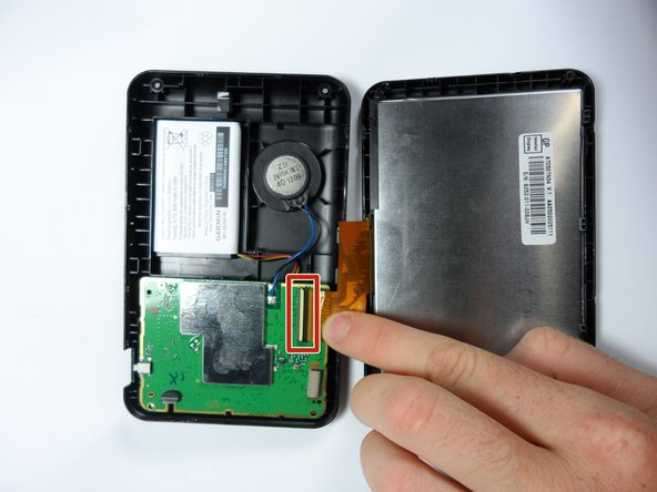 After the GPS unit is open, gently separate the orange ribbon cord connecting the LCD to the motherboard. Separate the cord at the motherboard.