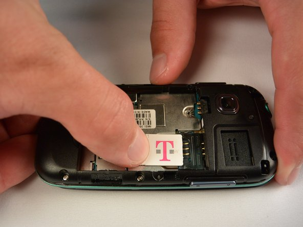 Slide the SIM card out enough to grab it firmly.