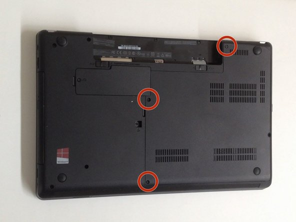 The HDD/Memory Cover is held by 3x Phillips screws. Remove them.