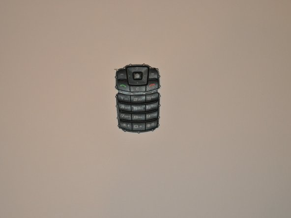 Replace the faulty keypad, and reassemble the phone.