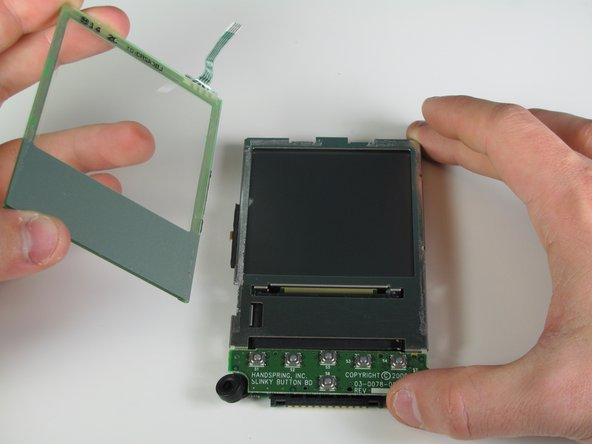 Slide the spudger down the length of the screen to detach from the frame.