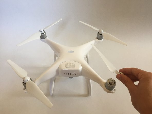 Push down and twist the propellers counter-clockwise to release from the drone.