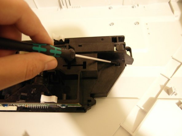 Remove the scan head's top cover by pressing the two notches on the back.