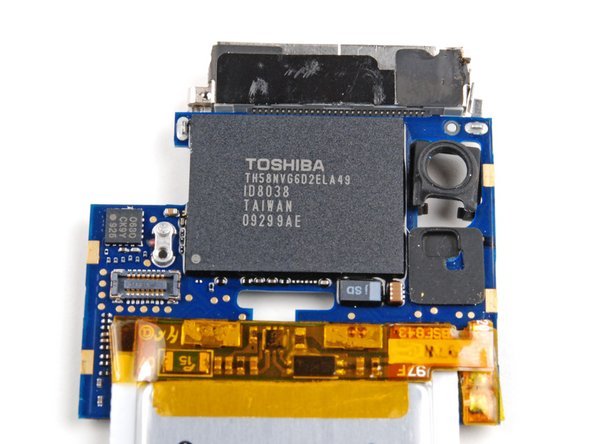 Image 1/1: In our iPod, Toshiba is the source for the 8 GB of flash memory. On the chip: