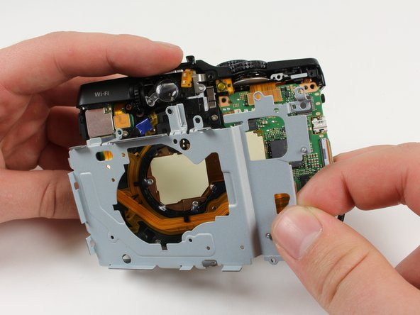 Image 1/1: Remove the metal casing from the back by lifting it away from the camera.