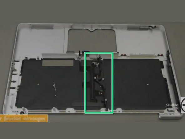Remove the 10mm phillips #00 screw.