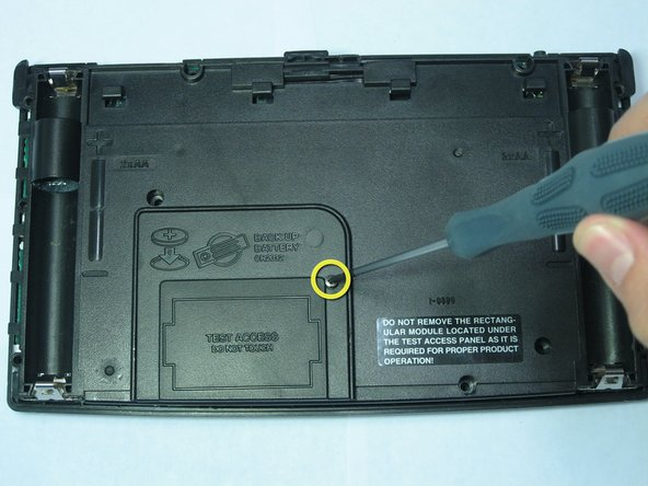 Image 1/1: Remove the panel being held by the screw.