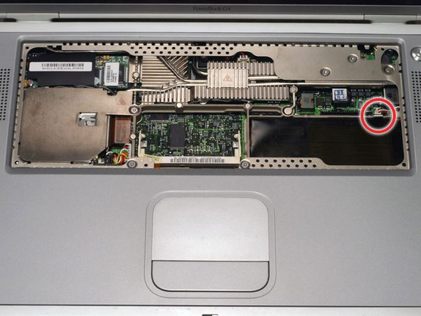 Bend the silver metal EMI clip so that it is vertical. This part may fall out after removing the DVD drive.