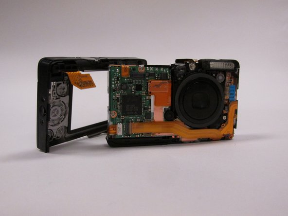 Now that you have removed all of the screws, carefully pull the case apart at the seem. The case will detach from the camera in two pieces.