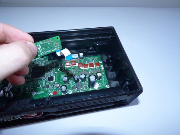 Image 2/2: Plug the new bluetooth chip into the motherboard and reassemble the device,