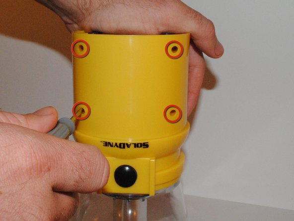 Remove 4 Phillips head screws from the front of the lantern body below the power button.