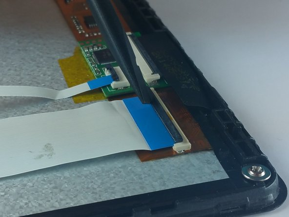 Image 2/2: Use ESD safe tweezers to pull the ribbon cables out  of the three connectors.