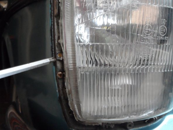 Image 1/3: To do so, locate the screws on the headlamp cover body, which are covered with a plastic frame. The outer-side screw aligns the fog lamp and the inner-side screw aligns the headlamp. Start your car,  turn on the fog lamps, and align them; then, turn off the fog lamps and align the headlamps.