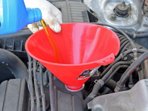 Image 2/3: Consult your owner's manual if you think your operating conditions call for a different oil viscosity.
