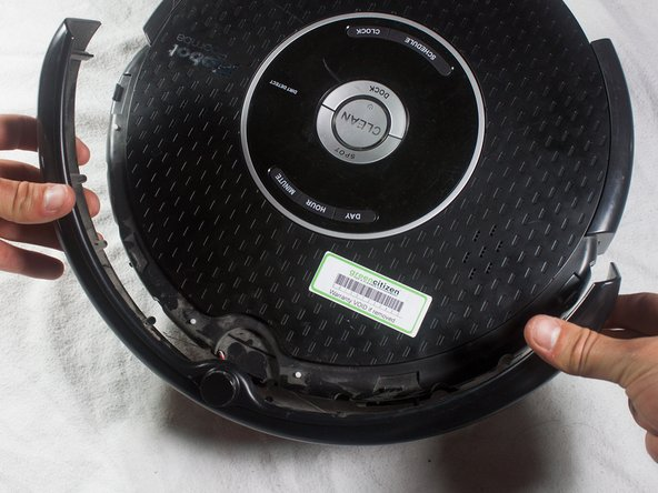 The battery is not secured in place once the bottom plate has been removed, and may fall out when the Roomba is turned right-side up.