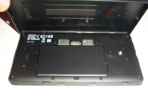 Once the back cover is removed, the battery will be in plain sight. It will need to be removed.