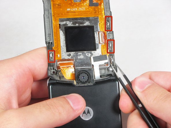 Using the tweezers, gently fold up the four buttons away from the phone's body.