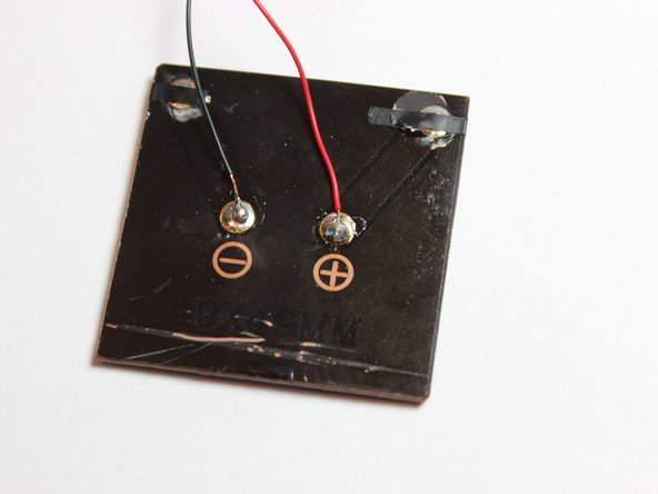 Using a soldering iron, melt the solder to attach the wires to the panel.