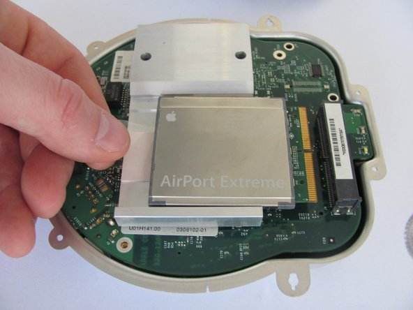 Lift and separate the top and bottom of the metal casing. You will now expose the motherboard and the AirPort card.