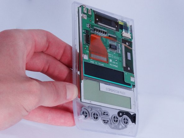 Image 3/3: Use the spudger (if needed) to pry the screen from the front case.