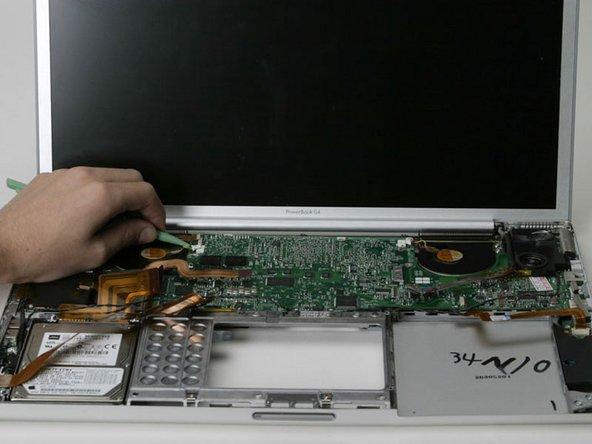Image 1/1: If the logic board does not immediately come free, it may be necessary to soften the thermal paste between the logic board and heat sink. You can soften the thermal compound using a hairdryer. Move the hairdryer back and forth between the two fans about one inch above the logic board for one minute. At this point, logic board should now come free easily.