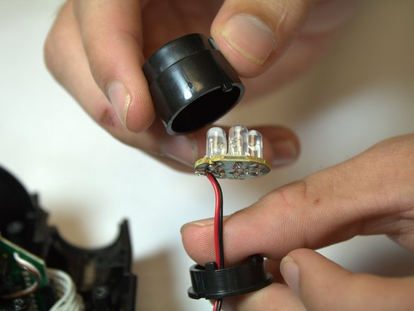 Use the soldering iron and desoldering braid to de-solder the wires from the lights.