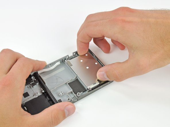 Lift the battery shield up and out of the lower case.