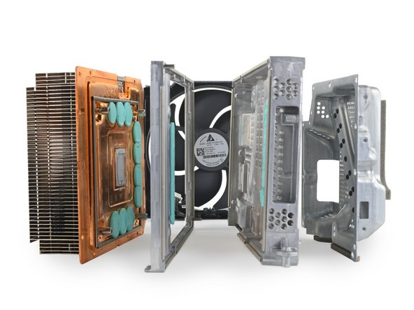 With the motherboards gone, we take a moment to admire the full cooling system. What a cool cookie sandwich.