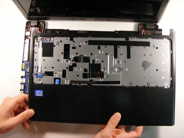 Open the computer and remove the inside cover.