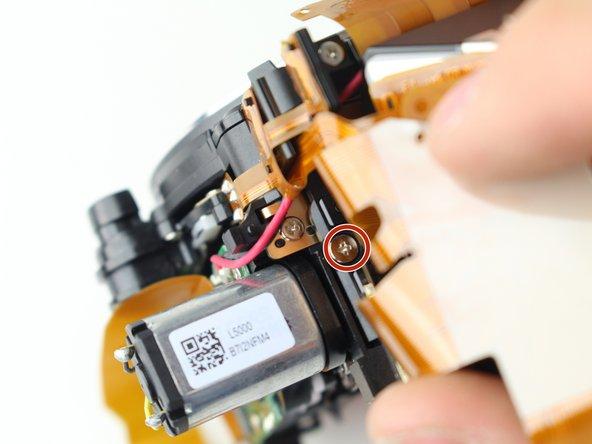 Remove the 5.5 mm J000 screw.