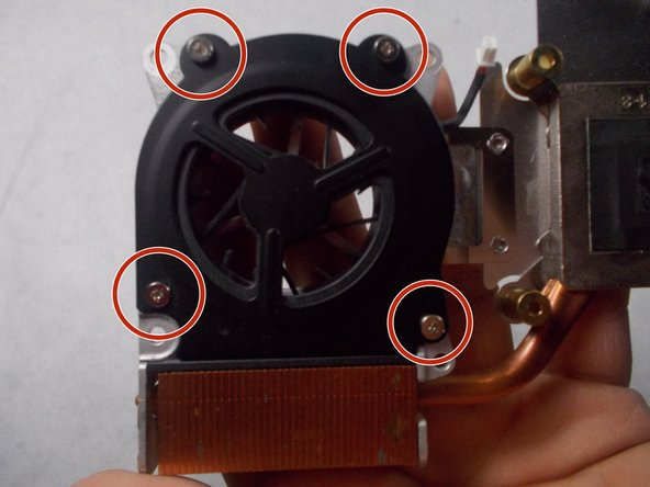 Turn over the fan assembly onto its backside so that the fan's metal protective cover is underneath it.