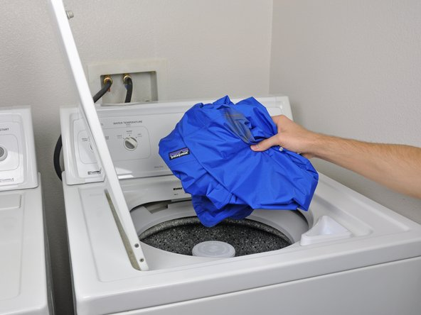 Place your jacket in the washing machine.
