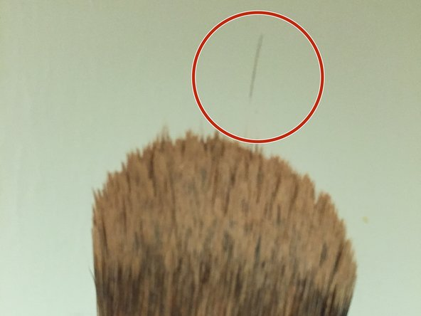 Cut off excess frayed bristles (optional).