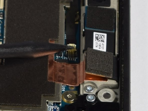 Pull the narrow flex cable up and out to detach it from the motherboard.
