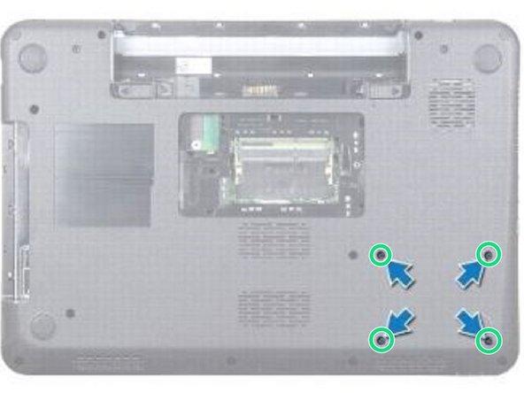 Retire los cuatro tornillos que aseguran el conjunto del disco duro.