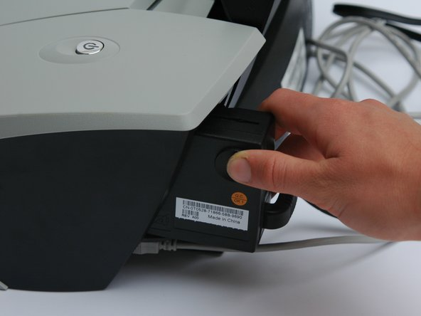Image 2/3: Pull outwards until the power adapter is disconnected from the printer.